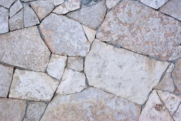 Декоративный камень для отделки стен: выбор материала, укладка, изготовление